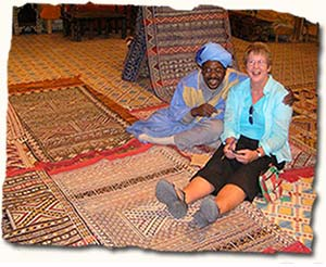 Shopaholic buying rugs in Morocco