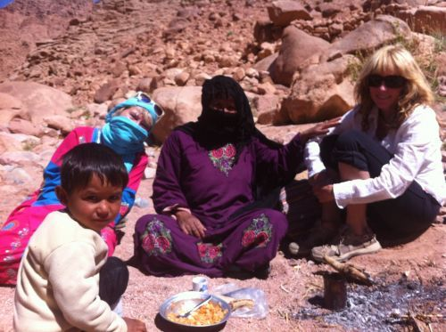 Having an impromptu tea made on the fire with a Bedouin lady out herding her goats in a local Wadi - as you do ©Venus Adventures