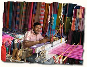Weaver in the souq, Egypt